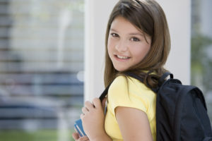 Smiling girl with a backpack.