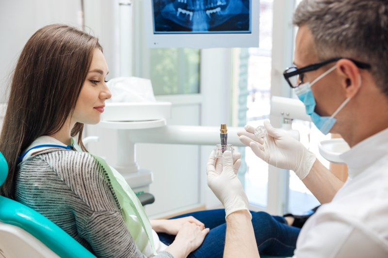 woman smiling talking to dentist