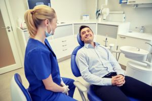 man smiling at his dentist in Burleson