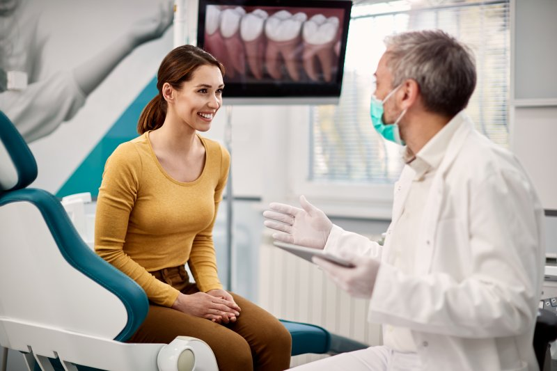 young woman talking with dentist